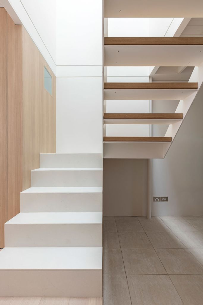 the delicate, light steel stairs allow light from the skylight to floor the heart of the home