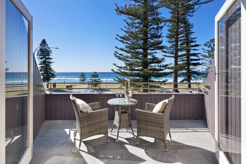 Terraces and views from all sides of this Manly dream beach house house