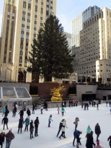 Ice skaters, with Prometheus (Paul Manship) and the Rockefeller Center Christmas tree.