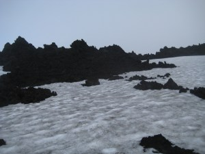 Lava fields in a misty landscape between the two glaciers.
