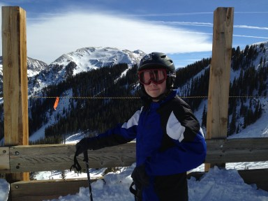 Ready to skitter down the slope at Taos.  Note blue skies, warm sun.