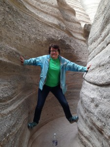 Playing in the slot canyons of Tent Rocks. During a heavy rain, these canyons become raging streams.