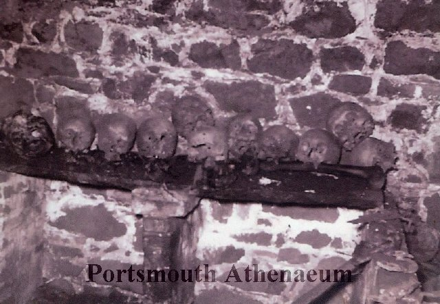 These skulls inside the Pepperrell Tomb are likely the remains of different members of the Pepperrell family, including Sir William. The photo, courtesy of the Portsmouth Atheneum, was probably taken by descendent and local historian Joe Frost, as it was found tucked into a book he had given the Atheneum.