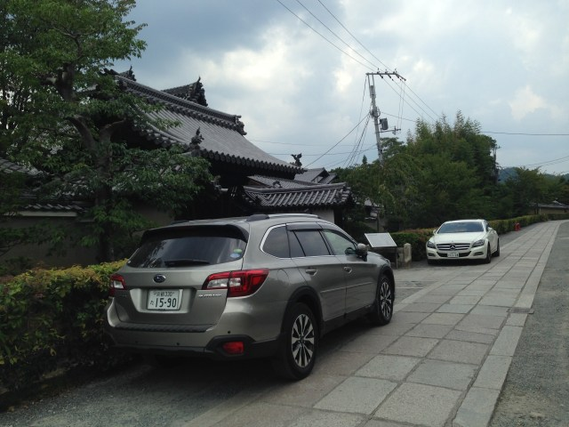"""In Kyoto, we stayed at the Shunkoin Temple guesthouse, which was located in the xxx temple complex, a vast walled working religious community with many private and public temples. Here, cars park in front of our temple, although by evening, all cars were out of site and we could walk these narrow """"roadways"""" and enjoy the site of the mainXXX temple lit up with hundreds of paper lanterns."""