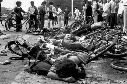 ** FILE ** The bodies of dead civilians lie among mangled bicycles near Beijing's Tiananmen Square in this June 4, 1989 file…