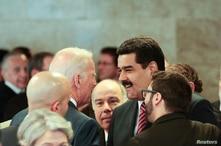 Venezuela's President Nicolas Maduro (2nd R) speaks with U.S. Vice President Joe Biden (C) during the sworn-in ceremony of…