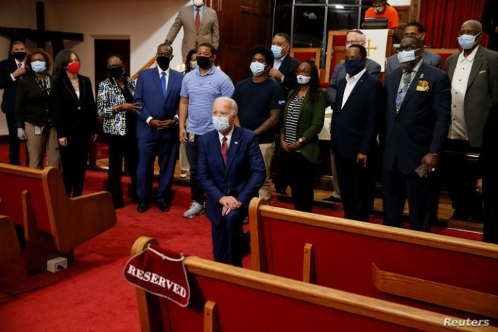 U.S. Democratic presidential candidate and former Vice President Joe Biden poses for a picture with Pastor of the Bethel AME…