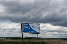 A weathered billboard stands along US 40 near Lawrence, Kan., Wednesday, May 6, 2020. The sign points to pre-virus times of a…