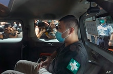 A 23-year-old man, Tong Ying-kit, arrives at a court in a police van in Hong Kong Monday, July 6, 2020. Tong has become the…