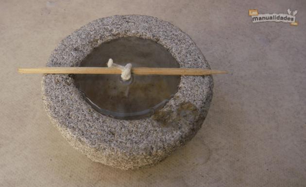 Velas de parafina y arena rellenado con parafina