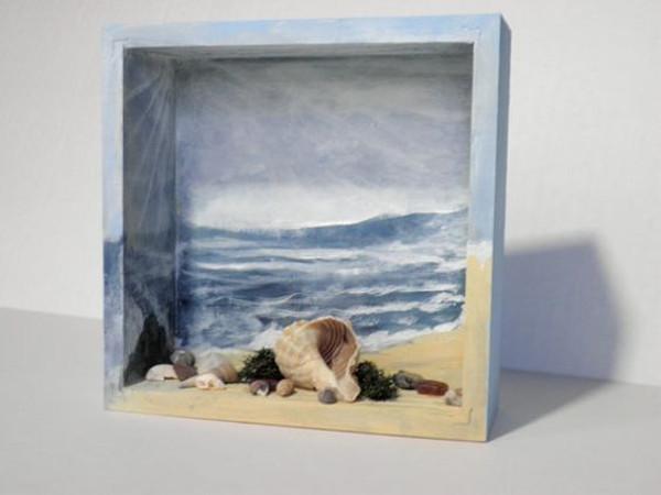 Diorama de caja con elementos de playa