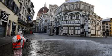 (FILES) In this file photo taken on March 21, 2020, an employee of the municipal company disinfects Piazza del Duomo, in Florence, as part of the measures taken by Italian government to fight against the spread of the COVID-19, the novel coronavirus. - Close to one billion people worldwide were confined to their homes on March 21, 2020, as the global coronavirus death toll shot past 11,000 and US states rolled out lockdown measures already imposed across swathes of Europe. The pandemic has completely upended lives across the planet, restricting movement, shutting schools and forcing millions to work from home. (Photo by Carlo BRESSAN / AFP)
