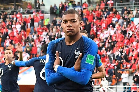 France's forward Kylian Mbappe celebrates scoring the opening goal during the Russia 2018 World Cup Group C football match between France and Peru at the Ekaterinburg Arena in Ekaterinburg on June 21, 2018. RESTRICTED TO EDITORIAL USE - NO MOBILE PUSH ALERTS/DOWNLOADS  / AFP / Anne-Christine POUJOULAT             / RESTRICTED TO EDITORIAL USE - NO MOBILE PUSH ALERTS/DOWNLOADS  FBL-WC-2018-MATCH21-FRA-PER
