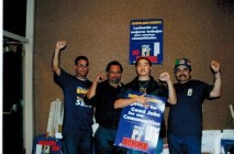 Image of my first civil disobedience arrest in 1999 with SEIU janitors. I'm standing in the center of 3 Chicano men with our fists raised.