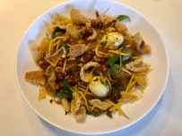 Mango salad with crunchy pork rinds and quail eggs