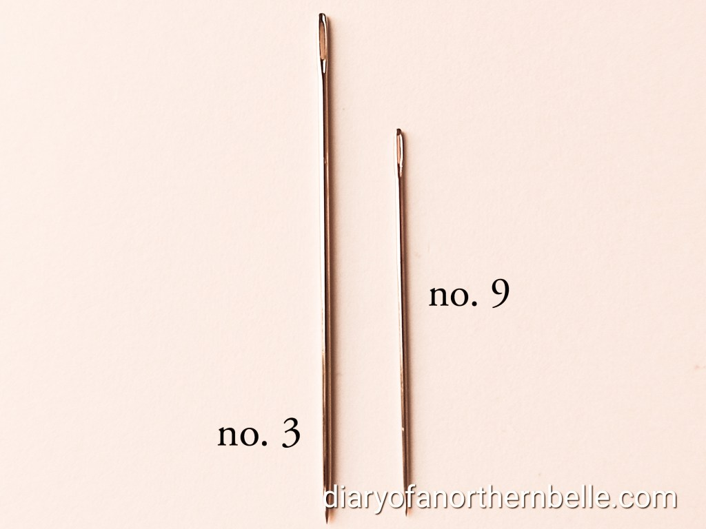 two different crewelwork needles, size 3 and size 9