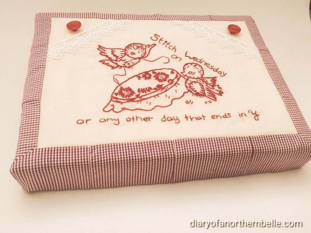 finished box covered with fabric and redwork embroidery