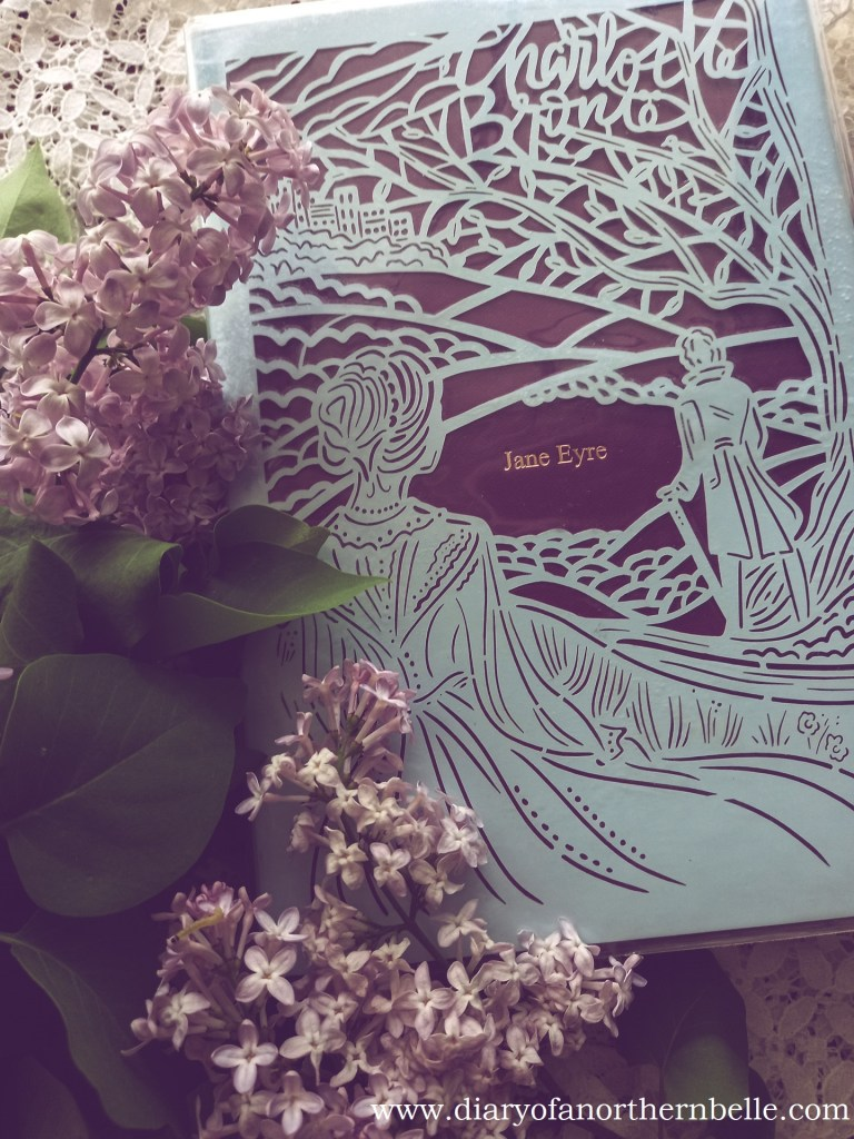 hardcover summer special edition of Jane Eyre surrounded by fresh lilacs