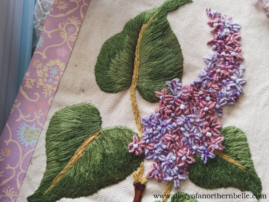 close up view of embroidered lilac branch