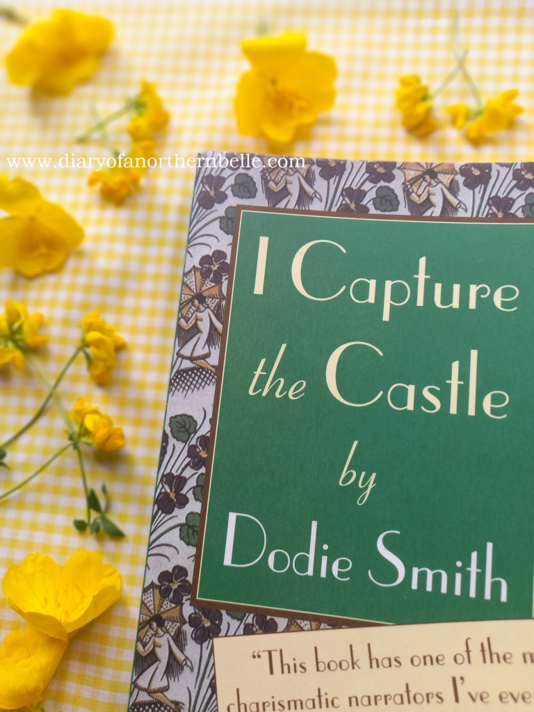 I Capture the Castle book copy surrounded by buttercups