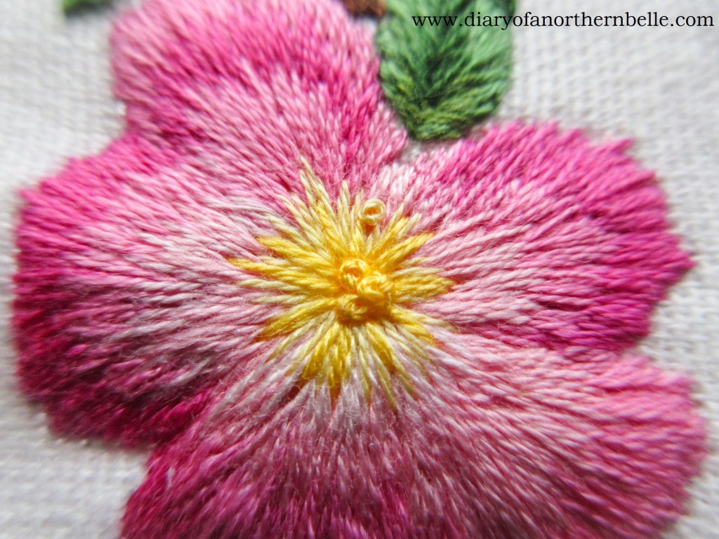 french knots in the very center of the embroidered wild rose