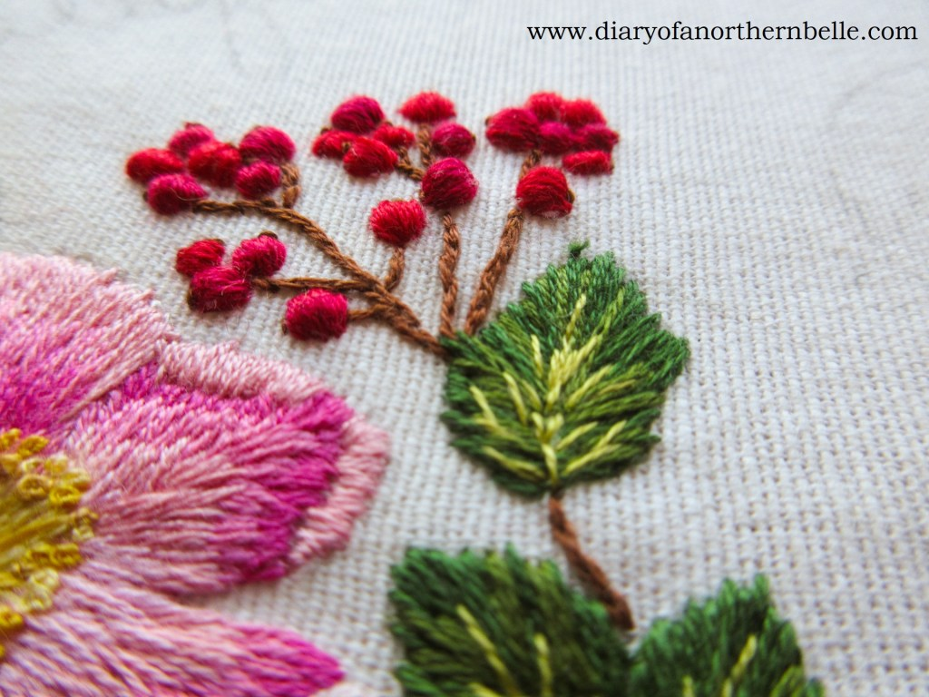 finished embroidered currant berry branch on garden bouquet project