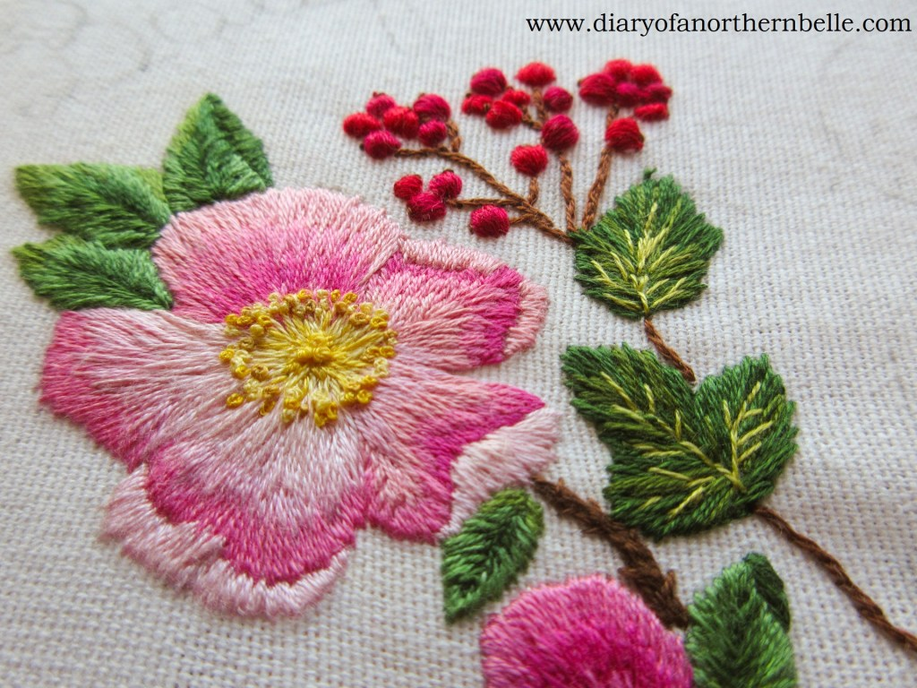 embroidered currant branch next to embroidered wild rose in garden bouquet project