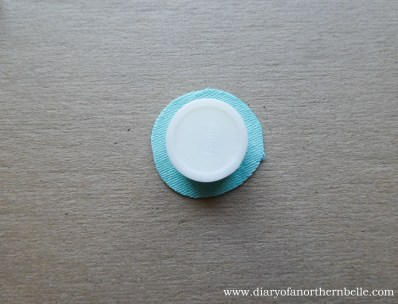 place the plastic holder right over the embroidery, the original button marking right around the edge of the holder