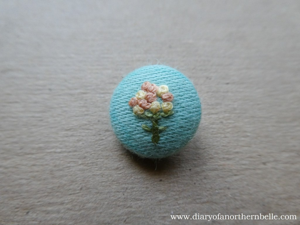 finished embroidered button seen from the front