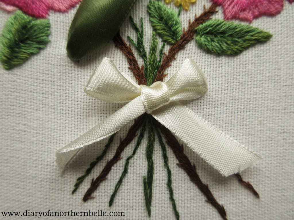 ribbon bow added around flower stems to tie the bouquet