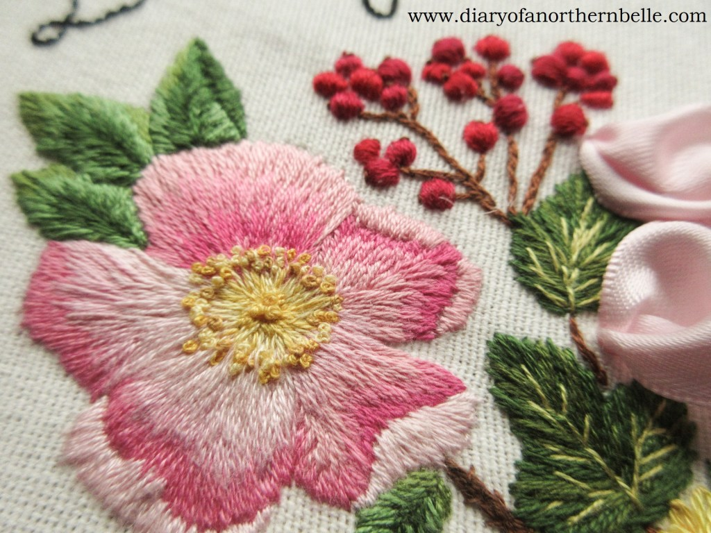 close up of garden bouquet details; wild rose and currant branch