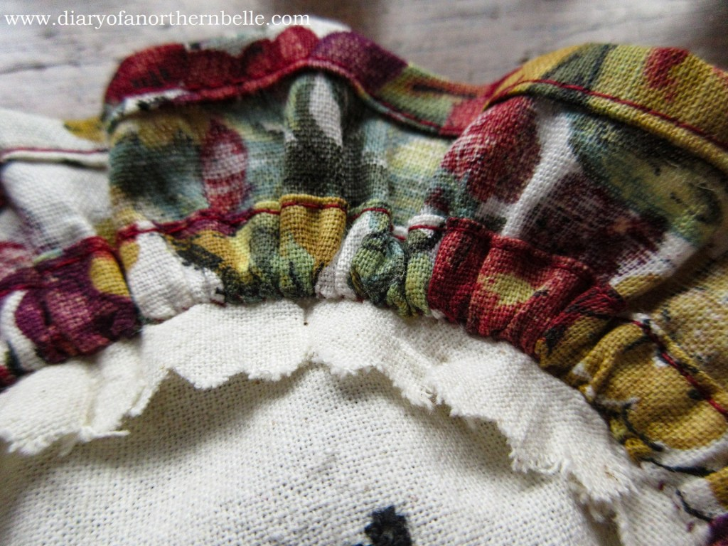 close up view of sewn ruffle to embroidery piece