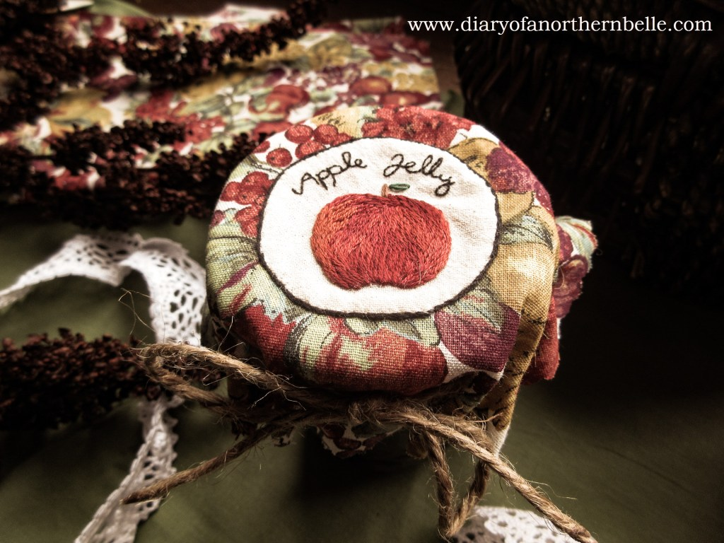 finished apple jelly embroidery jar bonnet tied around jar