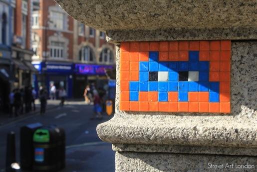 Mosaic street art mural by Invader