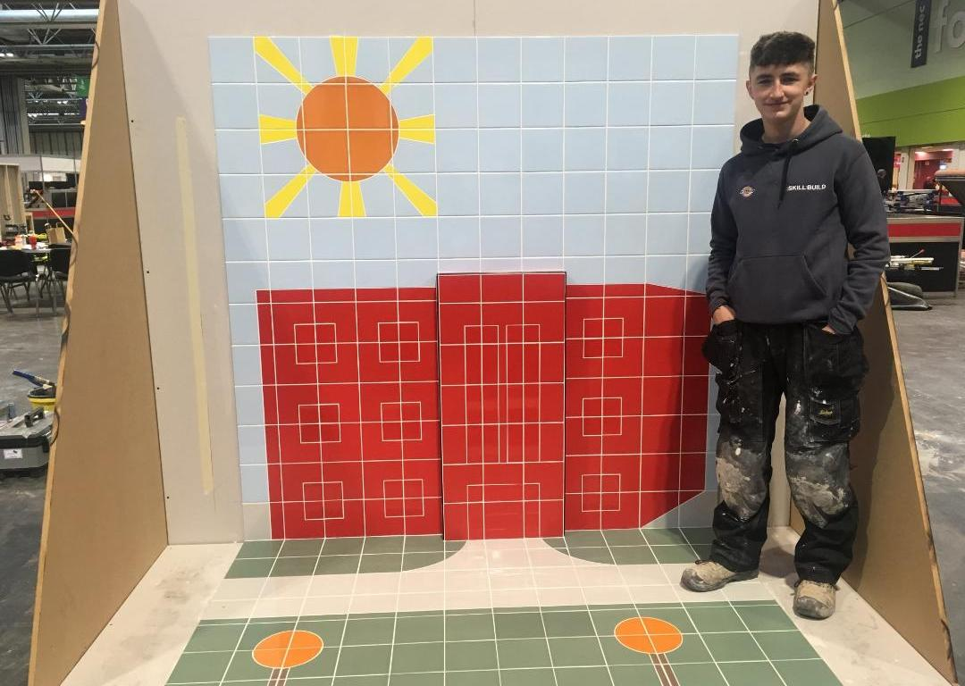 Odhran Connelly with his winning tiling creation at SkillBuild 2018