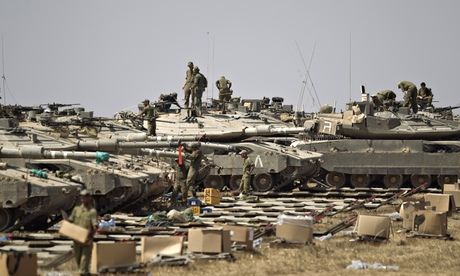 Israeli soldiers and tanks near the border with the Gaza Strip