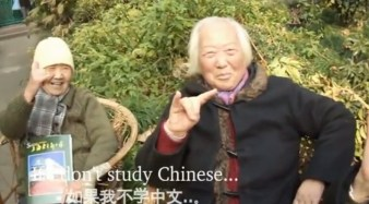 "Two Chinese old grannies holding up the ""shocker"" in a Death to Giants music video."