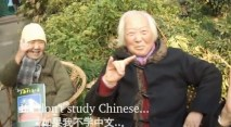 """Two Chinese old grannies holding up the """"shocker"""" in a Death to Giants music video."""