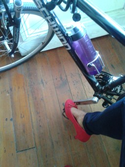 Black Femme Historian Biking in Crimson Heels. No, they didn't survive New Orleans.