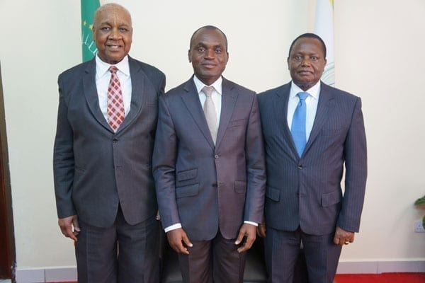Newly elected president of the African Court on Human and Peoples' Rights Justice Sylvain Ore from Cote d'Ivoire (centre) the outgoing president justice Augustino Ramadhani of Tanzania (left) and newly elected vice-president Justice Ben Kioko from Kenya after the elections on September 5, 2016. PHOTO | COURTESY