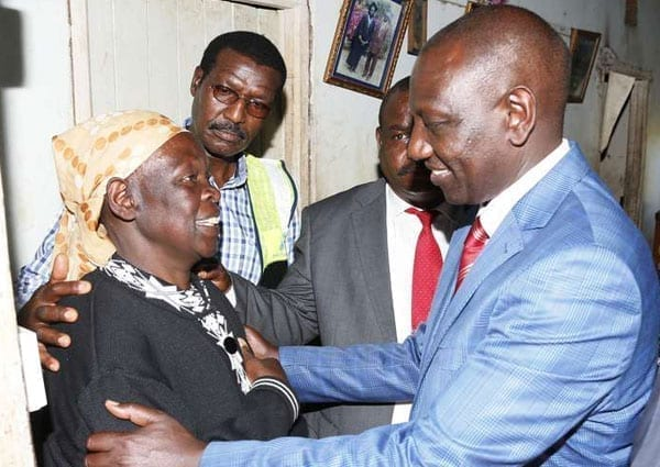 Deputy President William Ruto speaks to Anne Walelal after he launched the Last Mile Connectivity Project at Mois Bridge Likuyan in Kakamega on October 1, 2016. He has threatened to sue Boniface Mwangi for defamation. PHOTO | DPPS