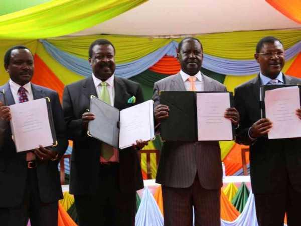 Opposition leaders Kalonzo Musyoka (Wiper), Musalia Mudavadi (Amani), Raila Odinga (Cord/ODM) and Moses Wetang'ula (Ford Kenya) after the signing of Nasa's agreement at Okoa Kenya offices in Nairobi, February 22, 2017. /COURTESY