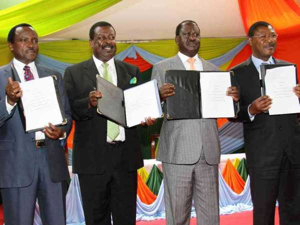 National Super Alliance principals (from L) Kalonzo Musyoka, Musalia Mudavadi, Raila Odinga and Moses Wetangula display the signed copy of coalition agreement that they will use to face the Jubilee Party in the August 8 elections on February 22, 2017. Photo/Jack Owuor