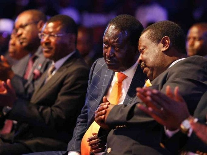 NASA presidential candidate Raila Odinga confers with Musalia Mudavadi of Amani National Congress during the launch of their manifesto in Nairobi, June 27, 2017. /JACK OWUOR