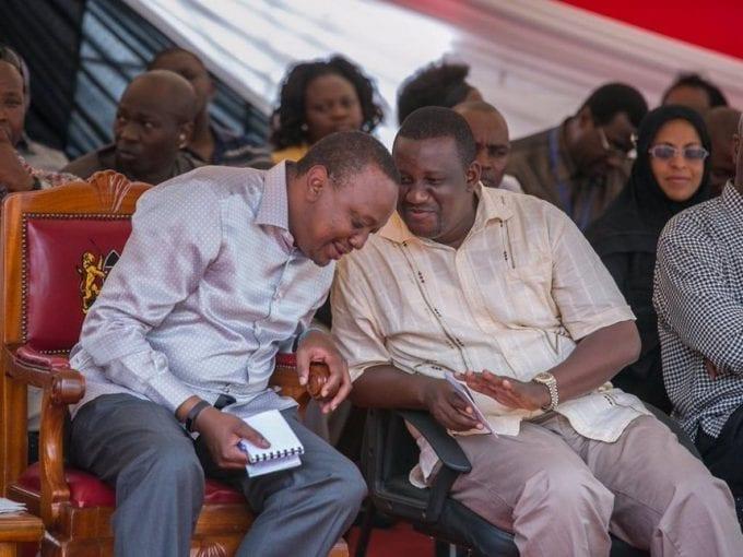 President Uhuru Kenyatta with Kwale Governor Salim Mvurya at Kikoneni Trading Centre in the county during a past tour. /FILE