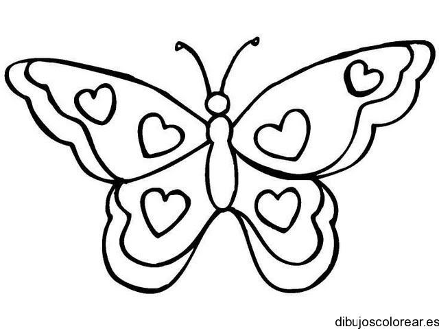 Dibujo de una mariposa con corazones