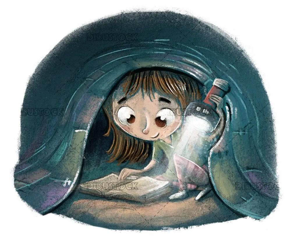 Boy reading a book with flashlight