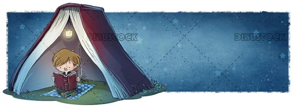 Boy reading a book at night