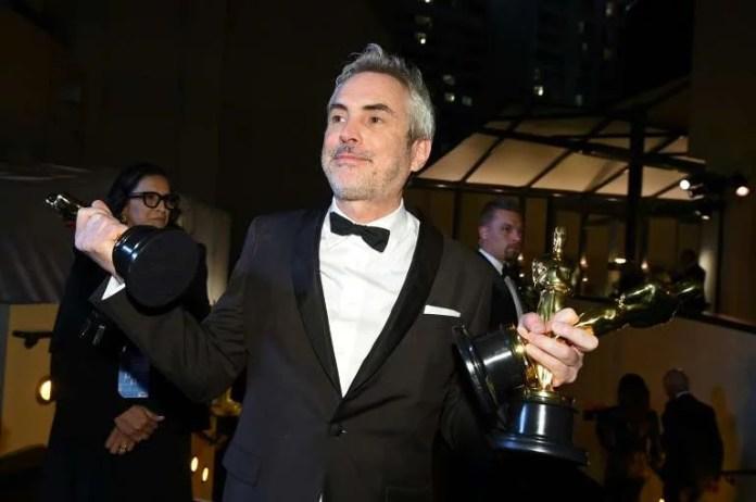 """© Robyn BECK Alfonso Cuaron recebeu três Oscars em 2019 por """"Roma"""", um filme da Netflix"""