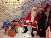 Santa and the Elf were very happy with the gifts the children brought for ' Action for Refugees in Lewisham'